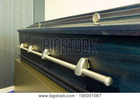 A blue coffin in a city morgue
