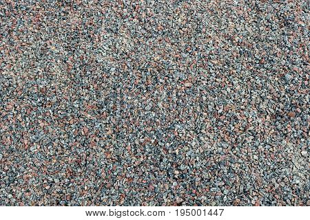 Gray brown background of small stones of building crushed stone