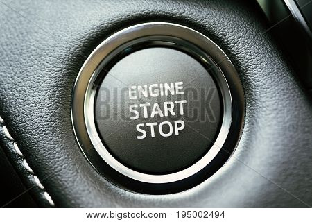 Engine start stop button on modern car dashboard