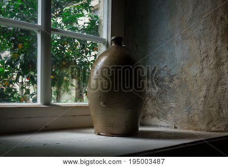 The old crock on windowsill in farmhouse.