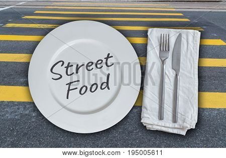 Street food plate with cutlery and street background.