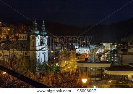 View of historical center of Karlovy Vary from hill in evening Czech republic