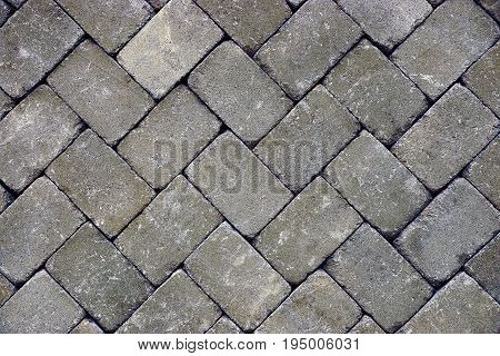 Gray stone background of paving tiles on the road