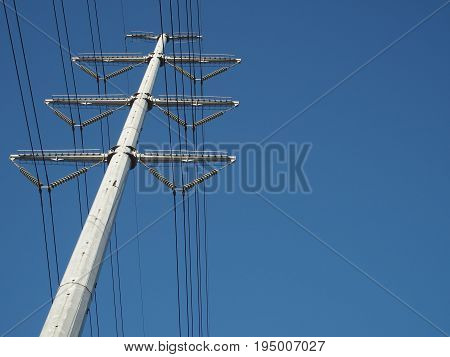 mono pole high voltage transmission line on clear blue background