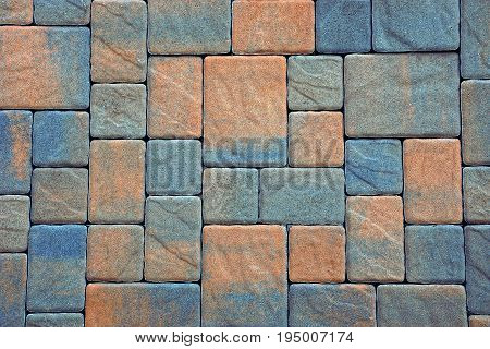Stone texture of colored paving slabs on the road