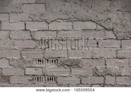 The Old Brick And Stone Wall With Plaster