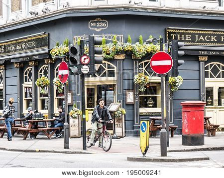 London, UK - March 19, 2017: outside view of The Jack Horner pub in London. Typical English pub with tables on the sidewalk at the intersection of Bayley Street