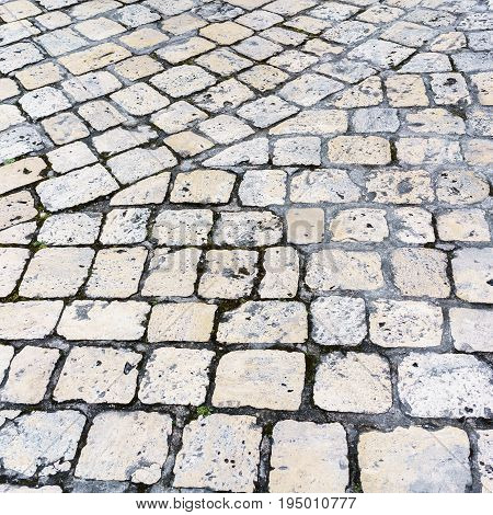 Stone pavement road in the old town of Cognac France