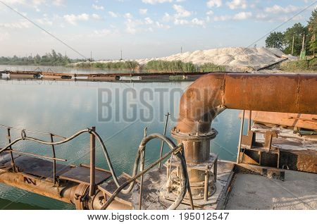 Iron Equipment In The Quarry For Sand Mining. Extraction Of Sand From A Sand Pit. Iron Technological