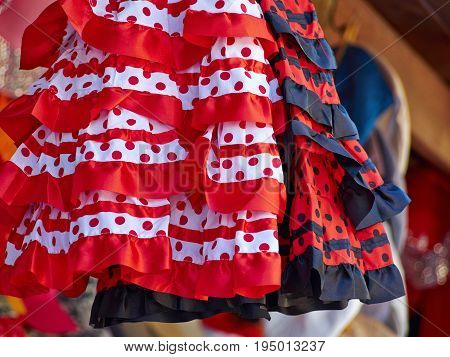 Beautiful traditional red flamenco dress hanged for display in a shop Spain