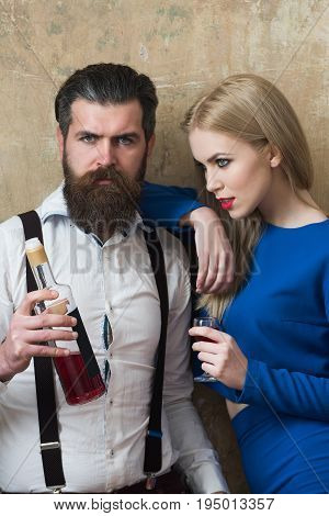 Man And Woman Posing With Bottle And Glass Of Liqueur