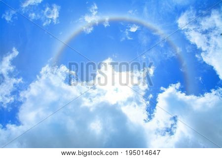 Sun Halo Over Blue Sky And Cloud As Background