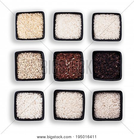 Various types of rice in black bowls isolated on white
