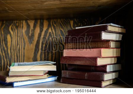 Read Paper book stacked on wooden in the interior of the library. Education and intelligence are well-read people. Old gadgets from short stories and novels. The passing of time read.