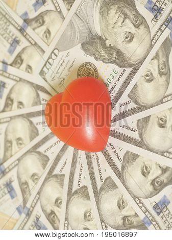 Red Heart On Hundred Dollar Bills Background
