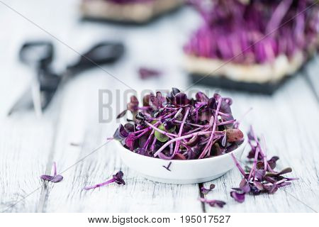 Portion Of Fresh Cutted Cress On Wooden Background (selective Focus)