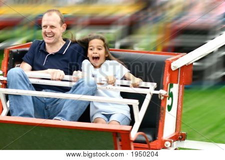 Father And Daughter On Octopus Ride