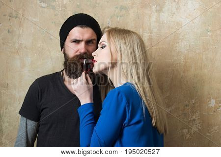 Woman And Man Posing With Bottle Of Liqueur