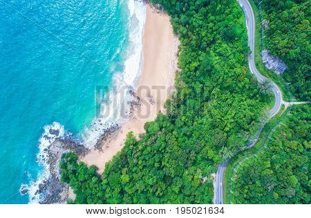 Sea aerial viewTop viewamazing nature background.The color of the water and beautifully bright.Azure beach with rocky mountains and clear water of Thailand ocean at sunny day.Winding road.