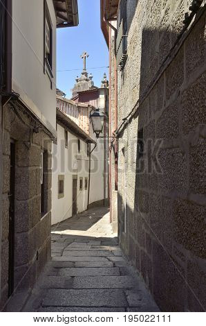 Stone narrow alley in the old town of Guimaraes Portugal.
