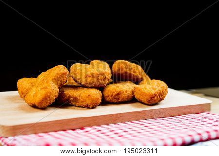Delicious fried Chicken nuggets on table