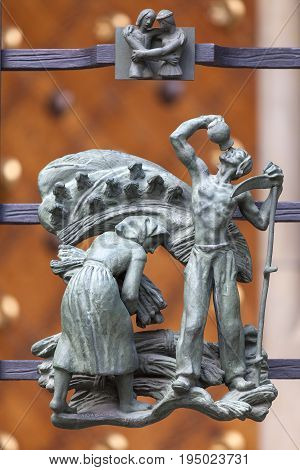 PRAGUE CZECH REPUBLIC MAY 1  2017: 14th century St. Vitus Cathedral details of Golden Gate fence small figures Prague Czech Republic. Cathedral is a Roman Catholic metropolitan cathedral in Prague the seat of the Archbishop of Prague.