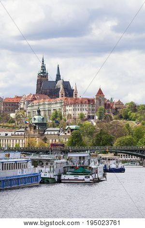PRAGUE CZECH REPUBLIC - MAY 2 2017: View of Hradcany and river Vltava with tourist boats. Vltava cruises are a great tourist attraction especially on sunny days