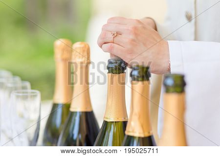 Hands Of The Steward Opening Bottles
