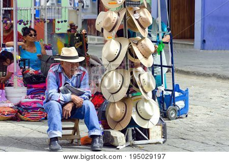 OAXACA MEXICO MARCH 4: Man sells hats in the street in Oaxaca Mexico on March 4 2017