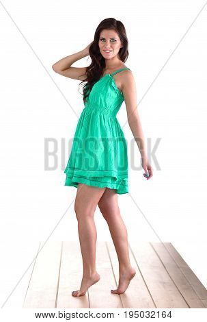 Fashion model wearing green dress, isolated on white background.