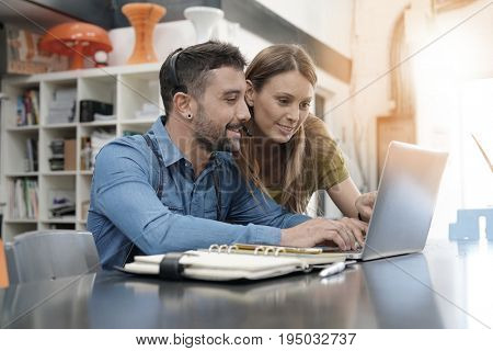 Start-up people working on laptop in office
