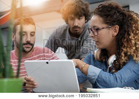 Young entrepreneurs working on digital tablet