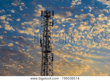 Telecommunication tower Antenna at sunset. Cellular antenna