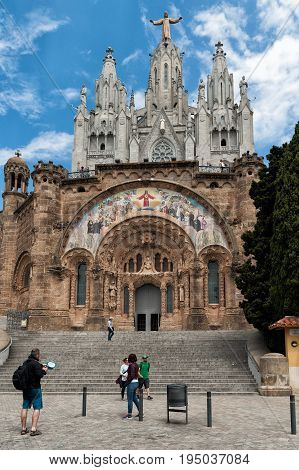 BARCELONA, SPAIN - MAY 2017: Tourists are visiting famous Temple of Sacred Heart of Jesus (Expiatori del Sagrat Cor ) on Tibidabo mountain in Barcelona, Catalonia, Spain.
