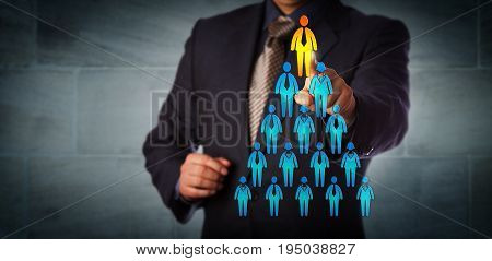 Blue chip recruitment manager selecting the employee icon atop a pyramid structure. Business concept for talent management network marketing career success corporate hierarchy and promotion.