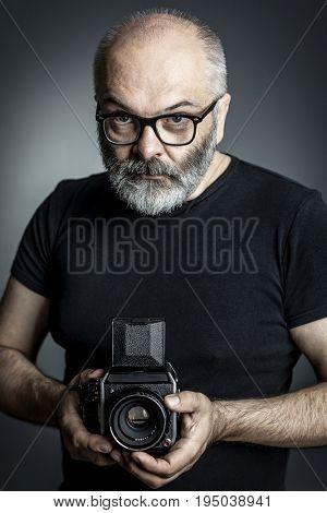 photographer with medium format film  camera
