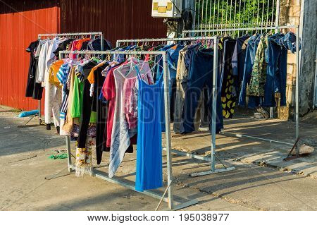 Clothes hanging on the street detail of clothes drying in the street in Asia Cambodia