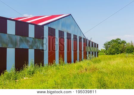 Red With White Stripes Building On The Airfield Field