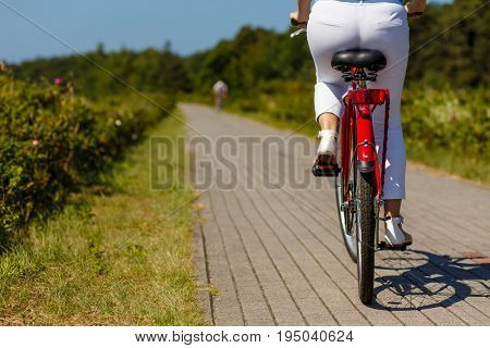 Woman riding bicycle at seaside
