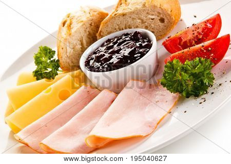 Breakfast - ham, cheese, bread and vegetables