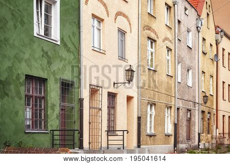 Facades Of Old Tenement Houses In Torun Old Town, Poland