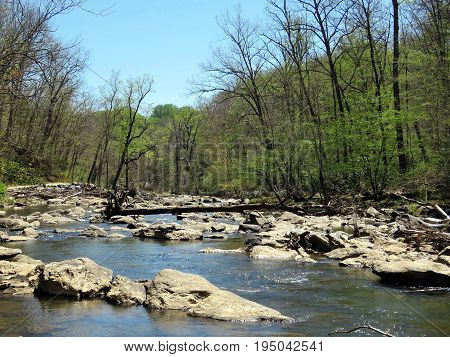Mclean, USA - April 18, 2016: Landscape of Mine Run Branch River tributary of the Potomac River.