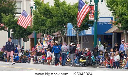 Alameda CA - July 04 2017: The Alameda 4th of July Parade is one of the largest and longest Independence Day parade in the nation. Unidentified persons assemble to watch the parade on Park Street.