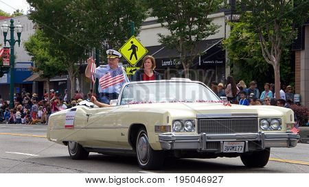 Alameda CA - July 04 2017: The Alameda 4th of July Parade is one of the largest and longest Independence Day parade in the nation. Vice Admiral Pac Area VADM Fred Midgette waves to the crowd.