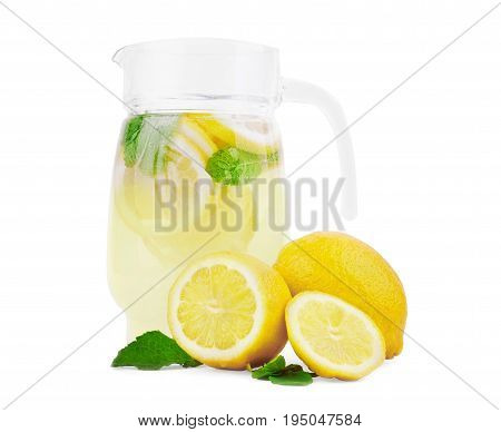 A jug full of summer mojito cocktail with lime, lemon, and mint, isolated on white background. A jar of lemon and lime water with fresh lemons, ripe lime and bright green mint.