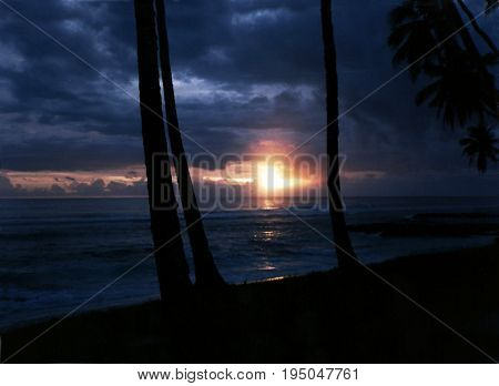 A view of a sunset on the South Pacific Ocean, from a beach on the island of Savai'i in Samoa.