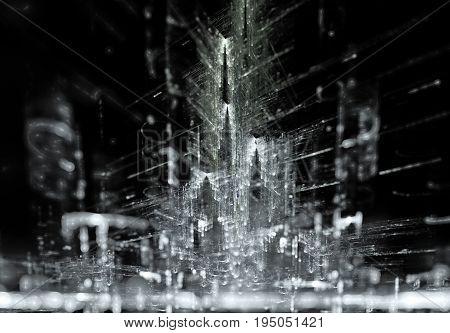 An artistic rendering of a vast metropolis at night.