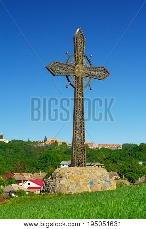 Kamyanets-Podilsky Ukraine - 19 May 2017: Cross near the Old Castle at Kamyanets-Podilsky Ukraine. The cross attracts tourists regularly.