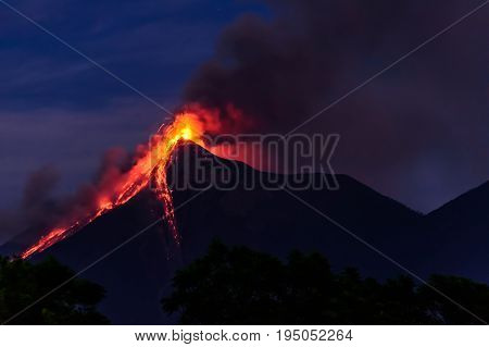 Lava spurts from erupting Fuego volcano at dawn near Antigua, Guatemala, Central America