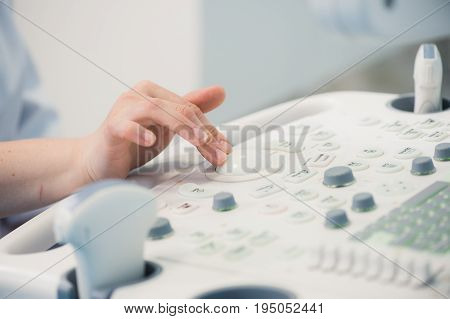young woman doctor's hands close up preparing for an ultrasound device scan